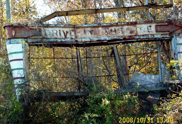 Authentic Americana:  There used to be a drive-in movie theater right here. The rusted roadside sign remains.