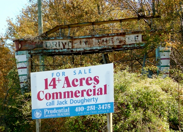 FUTURE ON HOLD: There's a bright new sign in front of the wreckage of the old drive-in movie sign. The 14 acres where folks once enjoyed movies outdoors on summer evenings, that real estate is still here.