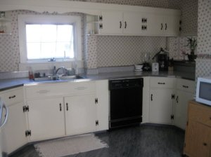 A charming kitchen with new appliances.