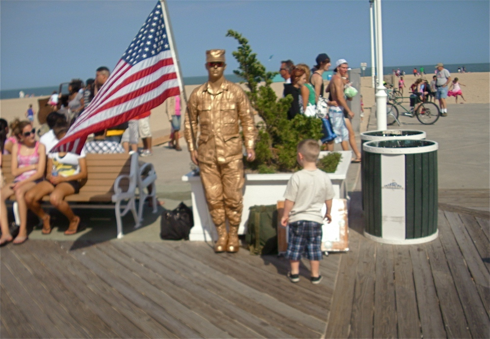 SOLDIER AT ATTENTION ON THE BOARDWALK AT OCEAN CITY, MD, MEMORIAL DAY, 2010.