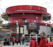"""The """"Red Porch"""" at the entrance to Nationals Park, selling food and spirits, featuring outdoor tables overlooking center field."""