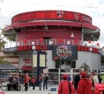 "The ""Red Porch"" at the entrance to Nationals Park, selling food and spirits, featuring outdoor tables overlooking center field."