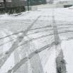 ABSTRACT ART, TIRE TRACKS IN SNOW