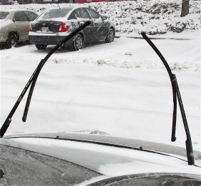 WIPERS UP SO THEY WON'T FREEZE TO WINDSHIELD